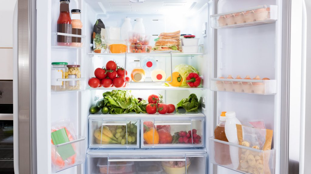 refrigerator with many foods and drinks inside