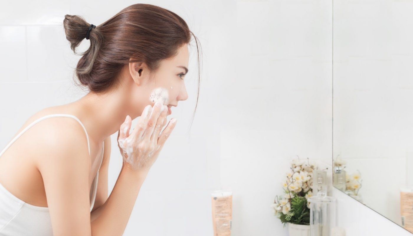 a girl washing her face