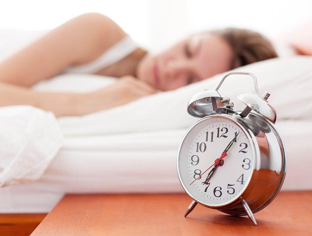 A girl sleeping, a clock